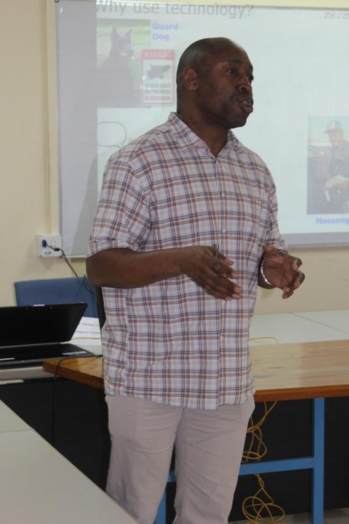 Del Atah delivering his presentation
