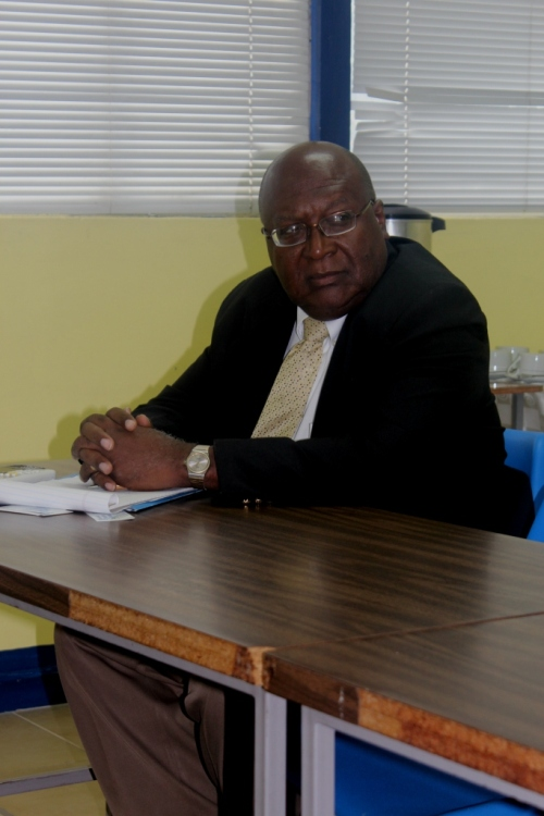 Executive Director Orville Johnson listens attentively
