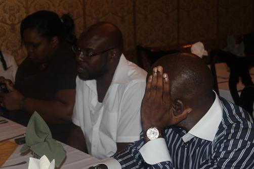 Head of Taxi Association Hurshel Cyrus flanked by Shelly-Ann Thorne and Femi Niyi hiding face
