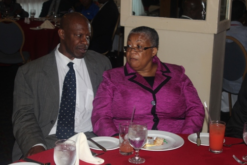Priority First UK / CENUK director Denis St Bernard aith Jamaica Stock Exchange Managing Director Marlene Street  Forrest