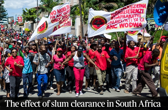 Scores of people stream down Foreman road to deliver a memorandum to their local councillor. They were calling for him to step down as their councillor as they alleged he is a corrupt ANC official who was allocating homes and jobs to his fellow ANC cronies..Photo courtesy www.thetimes.co.uk