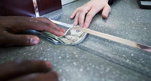 Saving money. Photo courtesy www.dailyfinance.com