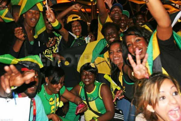 Jamaicans excited at their athletes performance at Olympics.Photo courtesy www.demotix.com