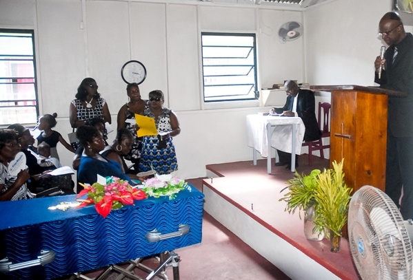 Minister Charles addressing the funeral service last Sunday