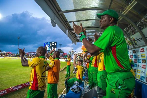 Players and officials of the Guyana Amazon Warriors applaud their teammates. Photo courtesy SKNIS