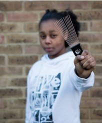 Teen arrested for Afro Comb fight