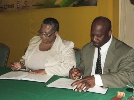 Street-Forrest and St Bernard sign MOU in 2011. Photo courtesy http://jamaica-gleaner.com/