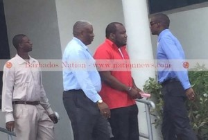 CEO of Phoenix Airways Neville Gumbs (second right) was arrested by police at his Hastings, Christ Church office yesterday. Photo courtesy http://www.nationnews.com