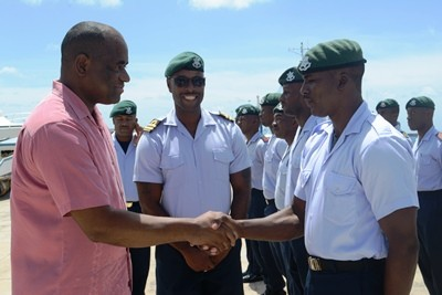 Dominica's Prime Minister, Roosevelt Skerrit thanking members of Barbados' armed forces for their support of that country's recovery efforts following the passage of Tropical Storm Erika in August. (C.Pitt/BGIS)