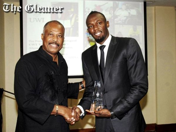 UWI Vice Chancellor Professor Sir Hilary Beckles (left) presents Dr The Hon Usain Bolt, OJ, Olympian, with the inaugural Vice Chancellor's Alumni Exemplar Sports Award at a ceremony at the Regional Headquarters of the University of the West Indies (UWI), Mona, yesterday. Photo courtesy http://jamaica-gleaner.com/
