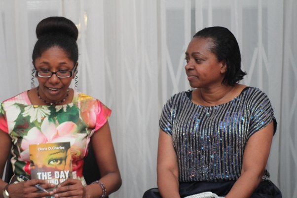 Doris in discussion with publisher Cindy Soso. Photo courtesy David F. Roberts / CaribDirect
