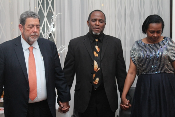 Adrian Jones leading closing prayer with Doris and PM Gonsalves. Photo courtesy David F. Roberts / CaribDirect