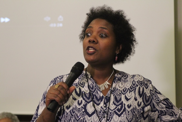 The effervescent Kesheniwa Aghaji outlines the back story of the Memorial Aid song. Photo courtesy CaribDirect