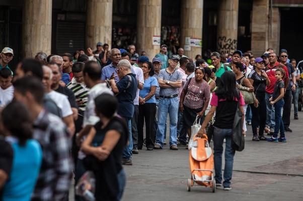 People wait in line to buy food in Caracas, Venezuela, on Feb. 6. (Meridith Kohut/Bloomberg)