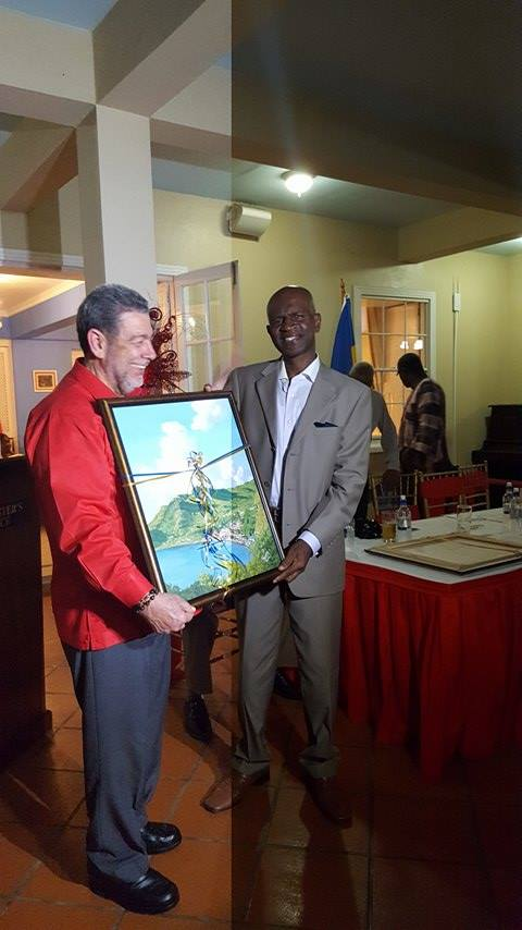 Hon. Maxwell Charles receives award from PM Gonsalves