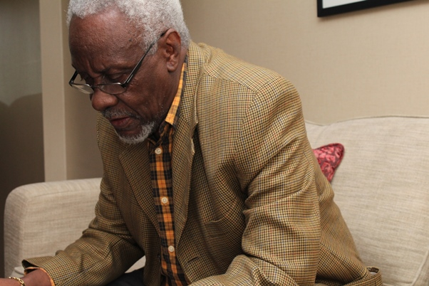 Hon. P J Patterson reviewing his notes prior to interview. Photo courtesy CaribDirect