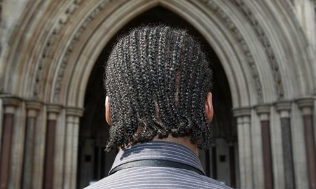 G, who was refused entry to St Gregory's Catholic Science College in Kenton, Harrow, north London, in 2009 because he wears his hair in cornrows, outside the high court. Photograph: Lewis Whyld/PA