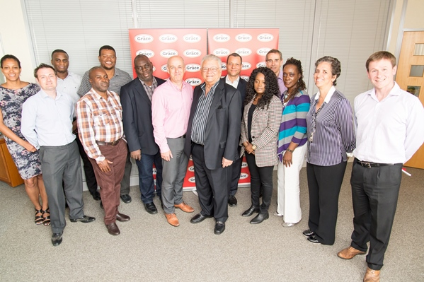 Photo shows trade mission delegates and Grace Foods staff with Hon. Minister Karl Samuda, Minister of Industry Commerce Agriculture & Fisheries (centre right) and Adam Reader (centre left), Grace Foods UK's Managing Director.