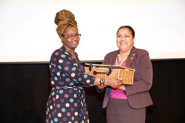 Mrs Carol Vaughan-Roberts, administrative director for CaribDirect presenting to Ms Carol Lee-Lea. Photo courtesy CaribDirect