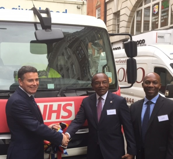 Ian Trenholm, CEO of NHS Blood and Transplant with Rudi Page (right) handing over bloodmobile to Hon. Minister Molwyn Joseph, Minister of Health, Antigua and Barbuda.