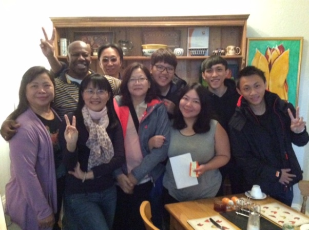 Denis with some of his Asian Guests at the Archway Guesthouse B&B in the Lake District, Cumbria.