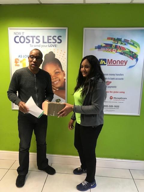 Caribbean Christmas Quiz sponsor JN Money representative Kimona Wilson picks the three luck winners