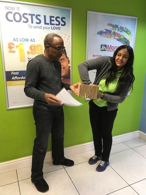 Caribbean Christmas Quiz sponsor JN Money representative Kimona Wilson picks the three luck winners with CaribDirect CEO David F. Roberts