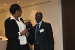 Minister Counsellor Mr Euclid Goodman chats with BFUWI official