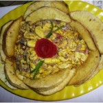 Caribbean Food: Achee and Saltfish (with corn pork)