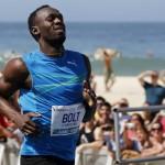 Usain Bolt Races on the Beach in Rio